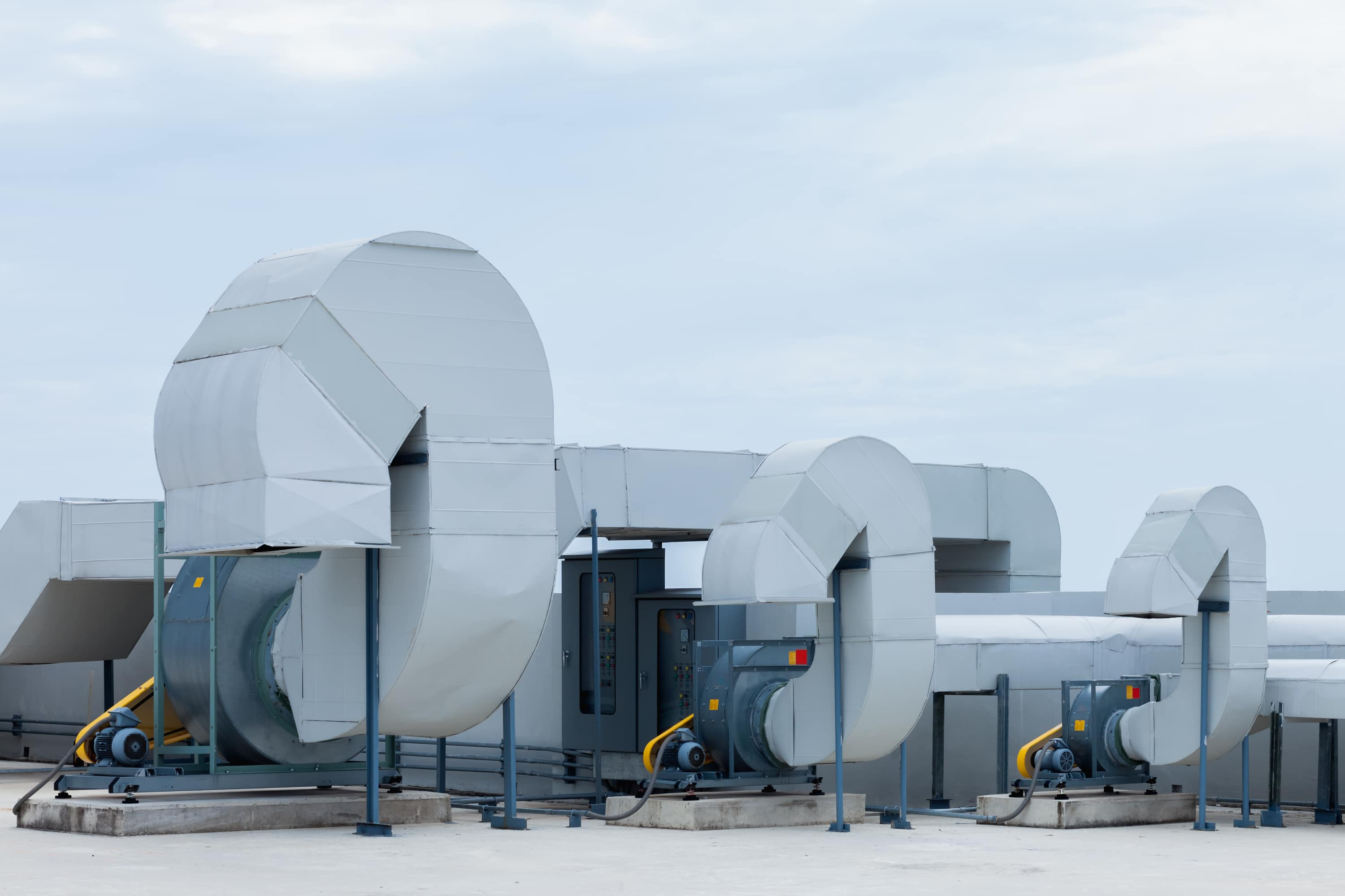 Industrial air conditioning units on a rooftop.